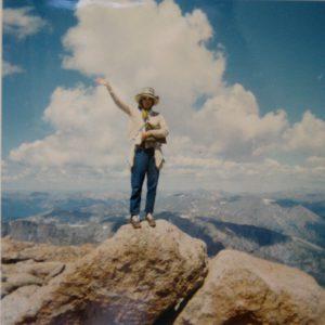 Mom waving from atop Longs Peak