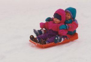Little girls on sled