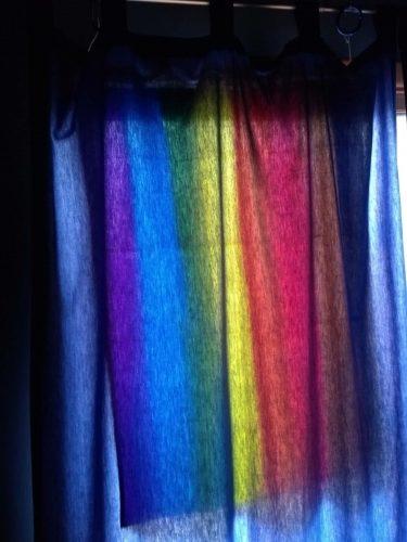 Rainbow flag through curtain