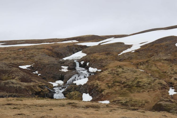 Snow melting in May in Iceland